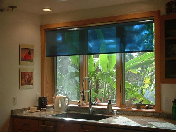 Halcyon shades on a window above a kitchen sink