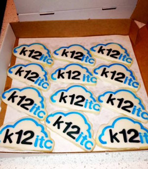 A box of cookies decorated with the k12itc logo