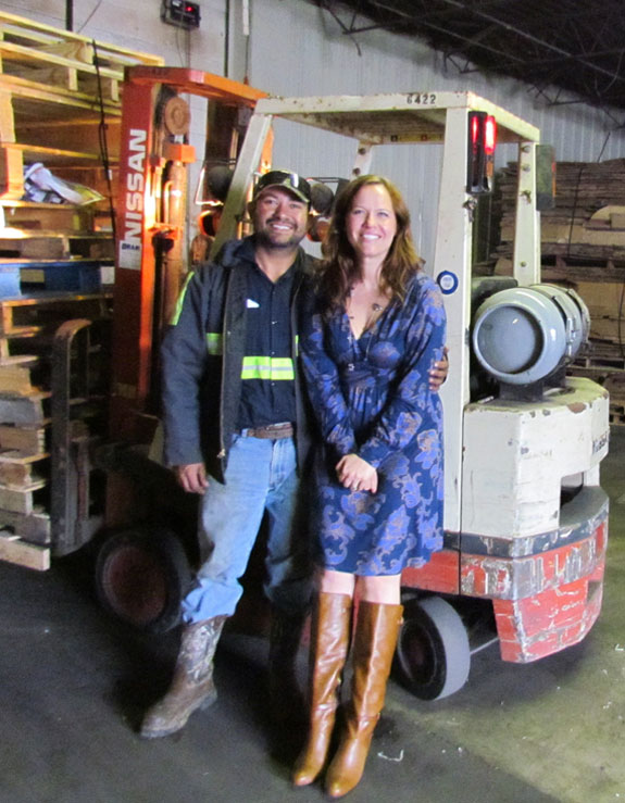 man and woman standing in front of equipment in warehouse