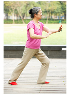 Woman in tai chi pose
