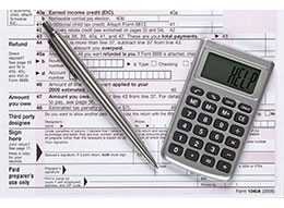 Calculator saying 'help' on top of tax documents