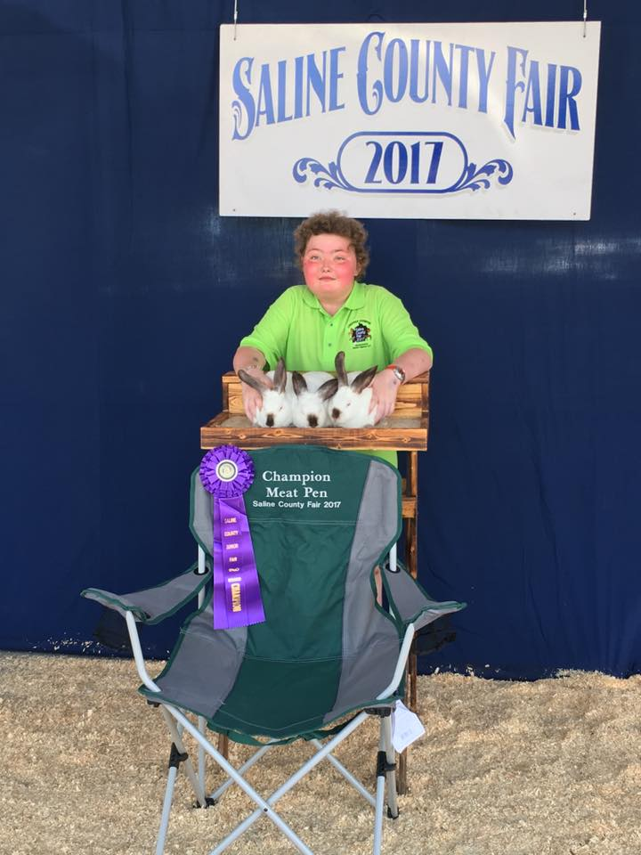Haley Browning with her champion rabbits.