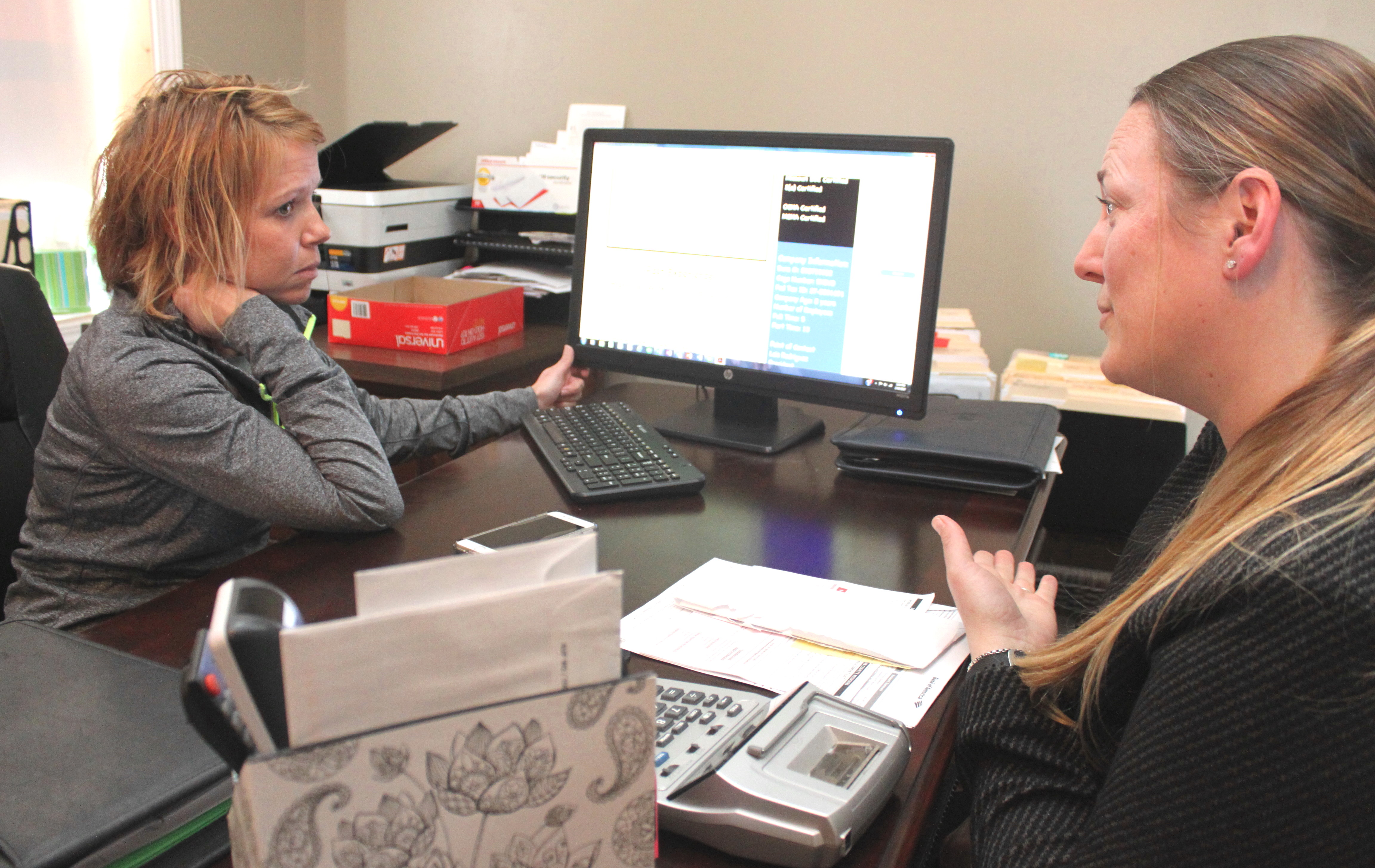 Rodriguez, left, meets with Jana Weitkemper, MO PTAC counselor, at BBD's headquarters in Brookfield, Mo.