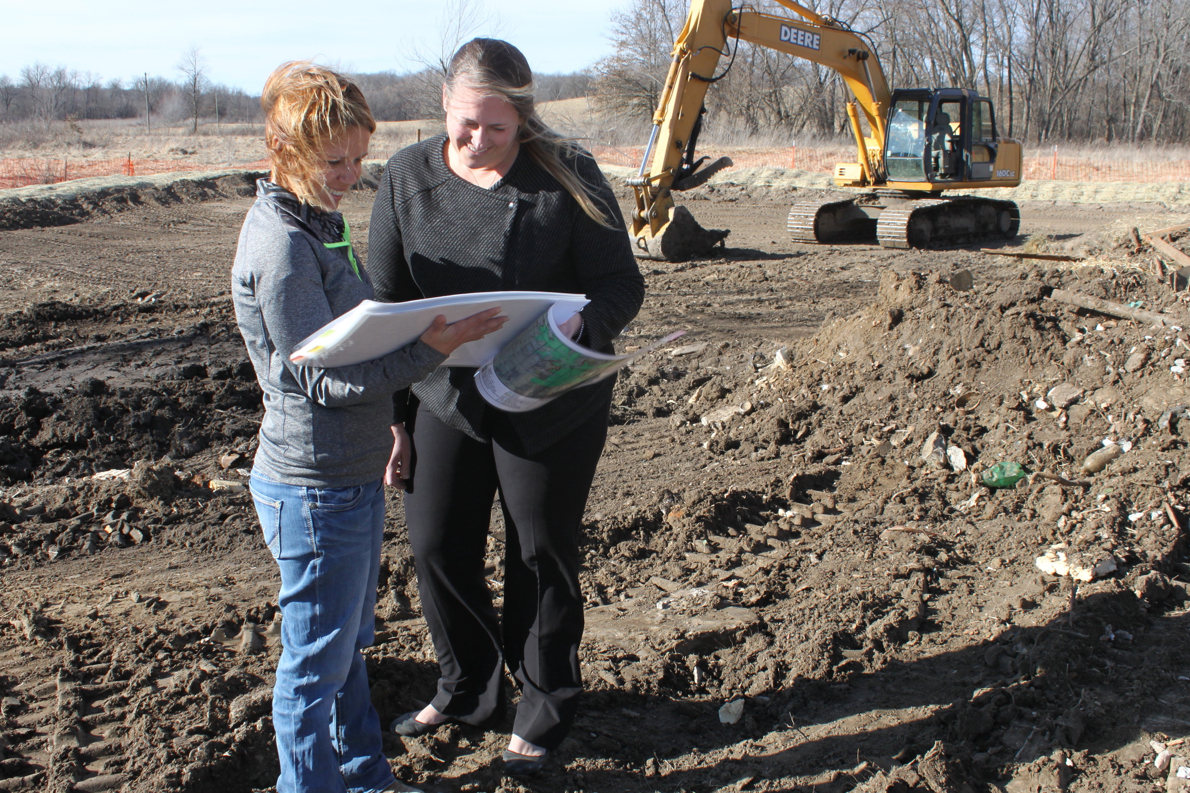 Rodriguez, left, reviews project plans with Weitkemper at one of the cleanup sites of the future 2,300-acre East Locust Creek Reservoir in Sullivan County near Milan, Mo.