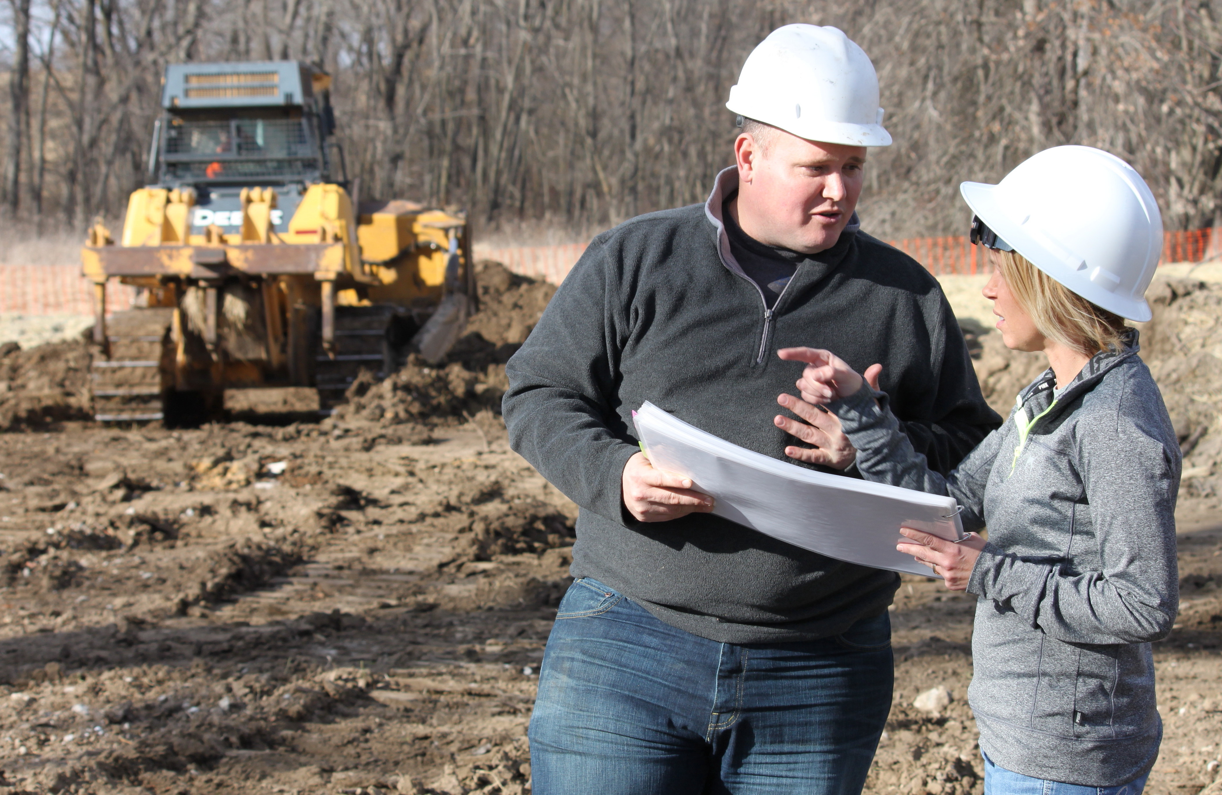 Rodriguez, right, consults with her company's chief engineer, Matt Thomas, on the East Locust Creek Reservoir site cleanup project.
