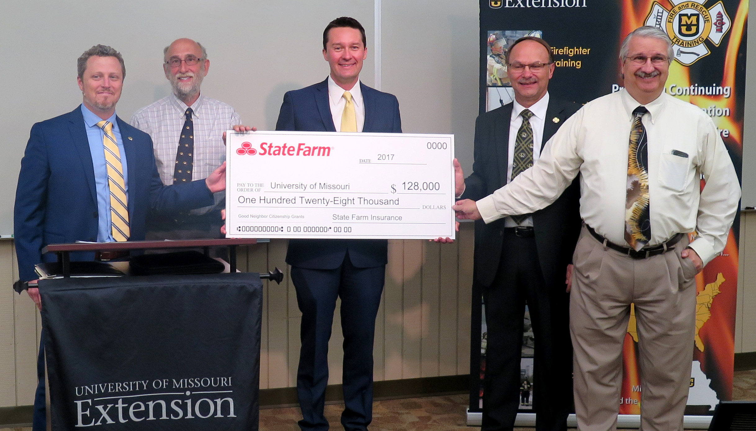 From left: Jake Logan, assistant vice chancellor for university programs; Sandy Rikoon, dean, College of Human Environmental Sciences; Ryan Kenney, State Farm agency sales leader for northeastern Missouri; Kevin Zumwalt, associate director, Fire and Rescu
