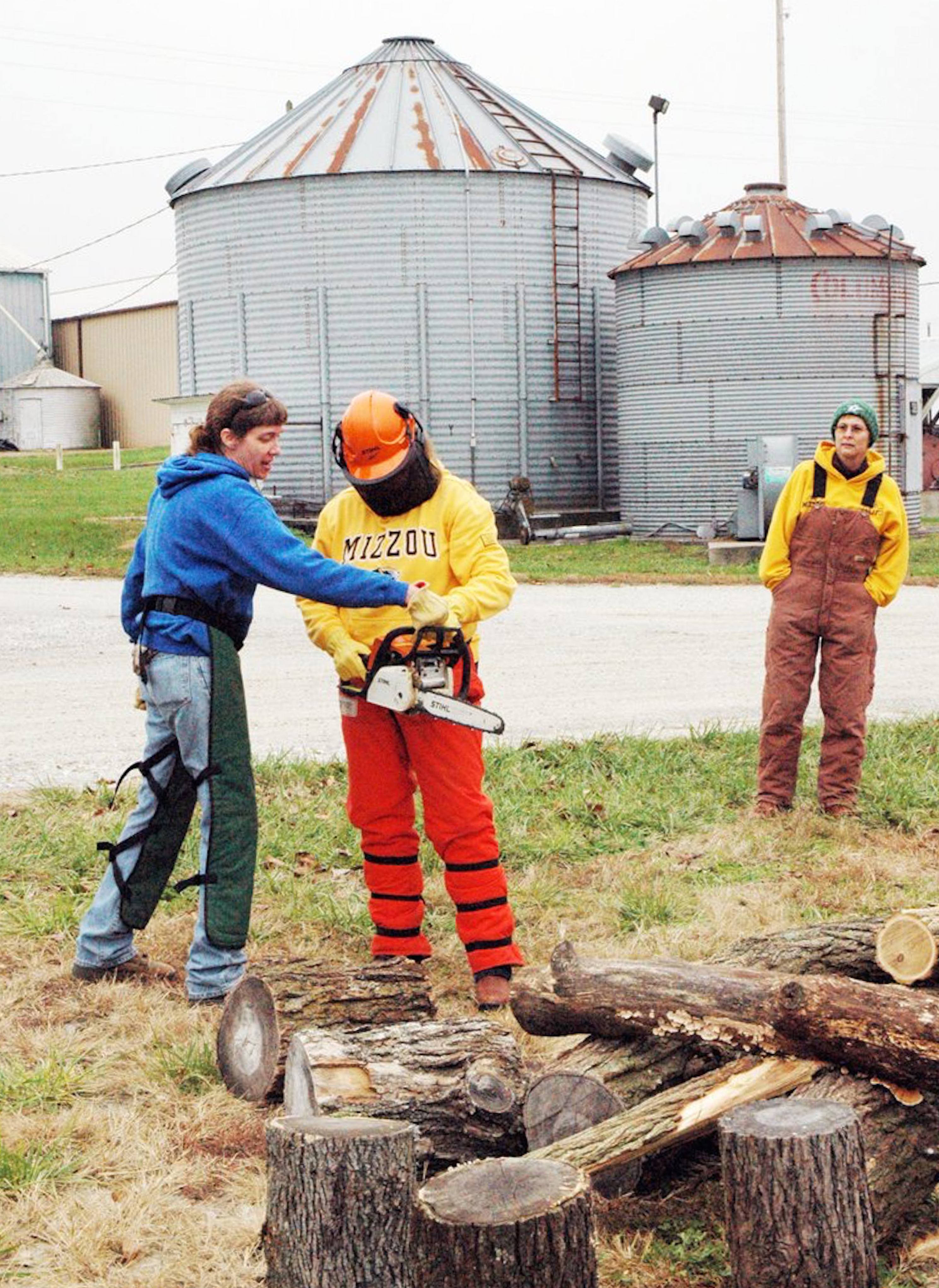 University of Missouri Extension horticulture specialist Katie Kammler gives tips on using chain saws at the recent Pearls of Production event for women livestock operators.