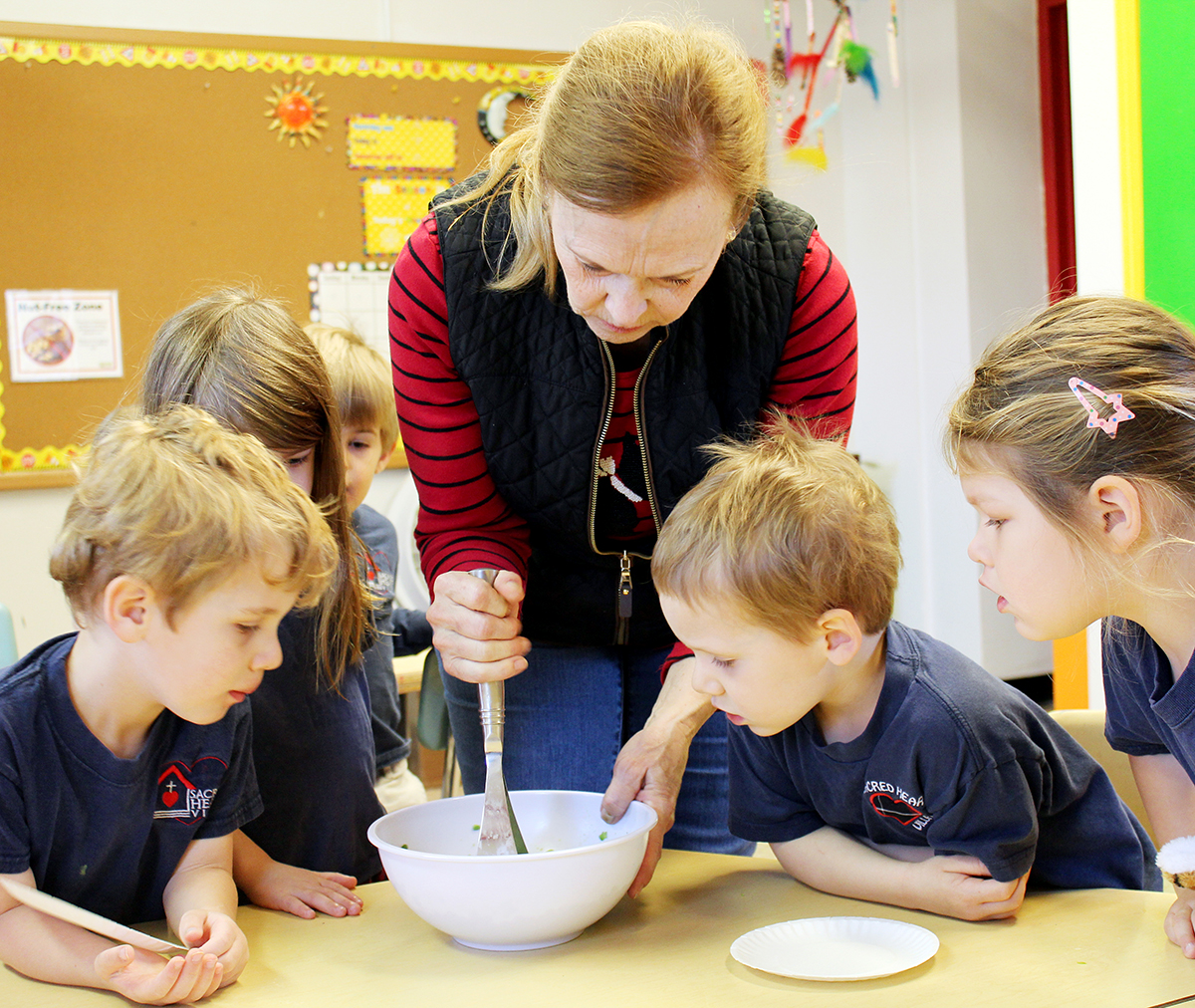 Students at Sacred Heart Villa Preschool on The Hill in St. Louis learn how to make 'smashy peas' from chef and Master Gardener Margaret Grant. Photo by Linda Geist.