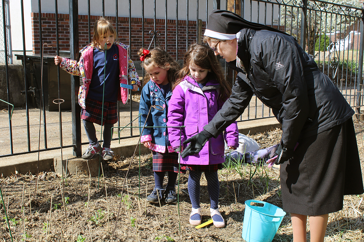 Students at Sacred Heart Villa Preschool learn gardening skills as part of the school's Outdoor Classroom program. They grow fruits and vegetables for their school lunches in 23 berms in the schoolyard. Photo by Linda Geist.