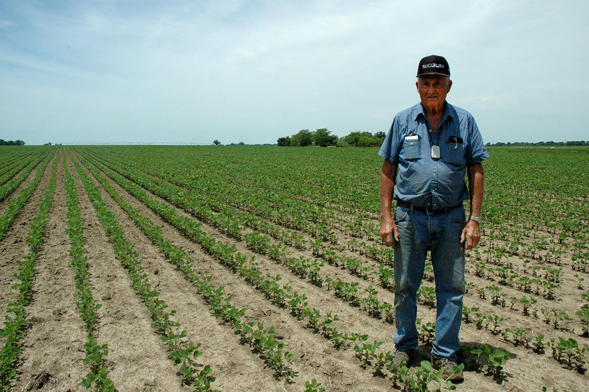 At 81, Russel Winter still likes to try new farm technology. He recently installed a subsurface drip irrigation system on an irregularly shaped plot of soybean. Photo by Linda Geist.
