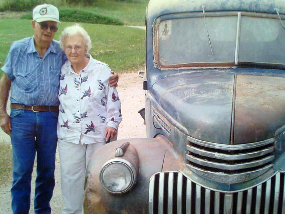 Earl and Marjorie Rogers next to Marjorie's father's truck, which came with them from Colorado. Photo credit: Shirley Peckman.