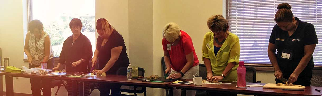 Cooking Matters participants cutting potatoes
