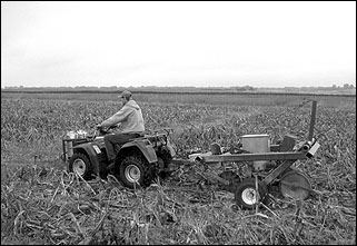 An all-terrain vehicle with a one-row, no-till planter.