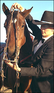 Maintain good control over the horse during bridling