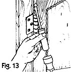 Figure 13, remove the pin from the hinges