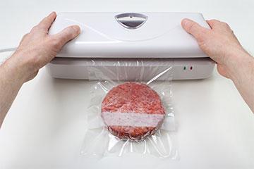 Vacuum packing a frozen hamburger at home